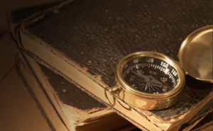 compass and old books